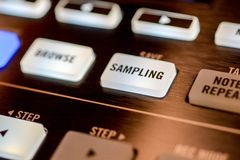 Buttons and pads on modern music machine. Background Photographed in macro, for the music industry or in the daily news for effect, on website for great royalty free stock image