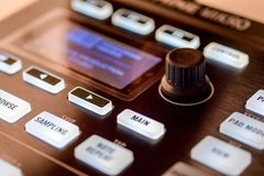 Buttons and pads on modern music machine. Background Photographed in macro, for the music industry or in the daily news for effect, on website for great royalty free stock images