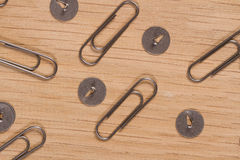 Buttons and paper clips on a wooden surface. Workshop scale models. Print for design studios and creative spaces. Do it yourself. Print for design studios and Stock Photos