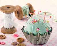 Buttons, pincushion, and other sewing items Stock Photo