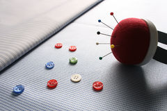 Buttons and pins. Fabric materials are posed for ad usage Royalty Free Stock Photo