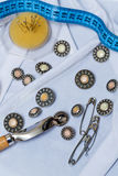 Buttons, pins, needles, measuring tape. Needlework. Royalty Free Stock Photo