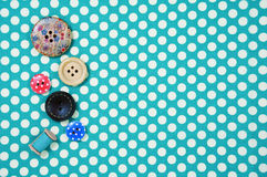 Buttons on polka dot fabric background Royalty Free Stock Photo