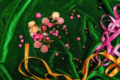 Buttons and ribbons on fabric Royalty Free Stock Photos