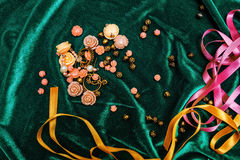 Buttons and ribbons on fabric Stock Photography