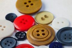 buttons samlingen färgrik Skillnadbegrepp closeup Arkivfoto