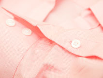 Buttons on a shirt sleeve Stock Images