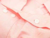 buttons skjortamuffen Arkivbilder