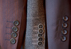 Buttons on a sleeve of man's suit Stock Photos