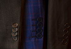 Buttons on a sleeve of a man's suit. Selective focus Royalty Free Stock Images