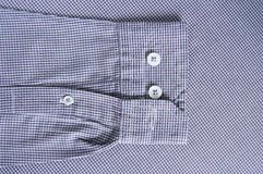 Buttons on sleeve and sew Stock Photos