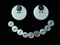 Buttons smile 3. Assorted buttons on black background Royalty Free Stock Photography