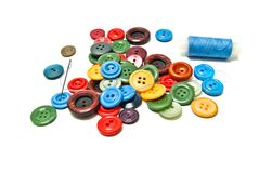 Buttons and spool of thread. Buttons and blue spool of thread on white background Royalty Free Stock Photography