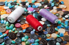 Buttons and spools of thread Stock Photos