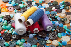 Buttons and spools of thread Stock Photography
