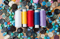 Buttons and spools of thread Royalty Free Stock Photography