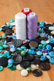 Buttons and spools of thread Stock Photo
