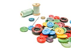 Buttons and spools of thread on white Stock Photography