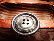 Buttons stacked on wooden chest toy craft Royalty Free Stock Photos