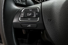 Buttons on steering wheel. Royalty Free Stock Images