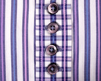 Buttons on a striped purple shirt Stock Photo