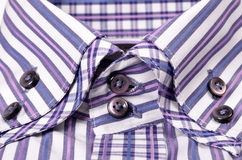 Buttons on a striped purple shirt Stock Photos