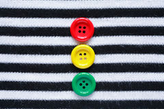 Buttons On Striped Vest Royalty Free Stock Photos