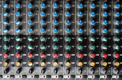 Buttons of a studio mixer. Closeup of buttons of a studio mixer royalty free stock images