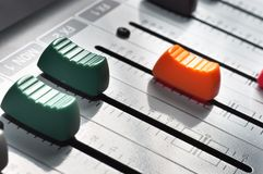 Buttons of a studio mixer Stock Photography