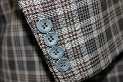 Buttons in a Suit. Closeup of buttons on a business suit coat Royalty Free Stock Photos