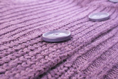 Buttons on sweater. Buttons on violet sweater, horizontal picture Royalty Free Stock Images