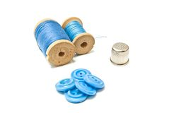 Buttons, thread and thimble. Thread, buttons and thimble on white background closeup Royalty Free Stock Images