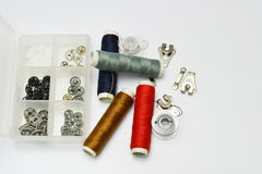 Buttons and thread Stock Photos