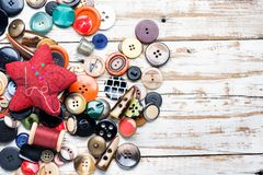 Buttons and threads with needle stock photo