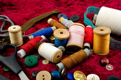 Buttons and threads on red background Royalty Free Stock Photo