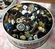 Buttons Tin. Retro Roses Chocolates tin full of àssorted buttons Royalty Free Stock Photos