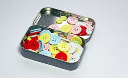 Buttons in a tin. Royalty Free Stock Photos