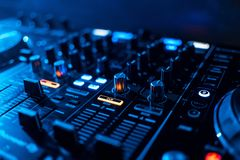 Buttons and volume levels and mixing music on professional Board DJ. To play music Royalty Free Stock Photo