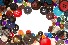 Buttons. Are on white, pile of plastic , creative frame Royalty Free Stock Photography