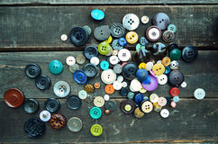 Buttons on wood planks Stock Photography