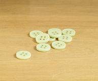 Buttons on a wood table Royalty Free Stock Image