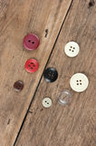 Buttons on a wooden board Royalty Free Stock Images