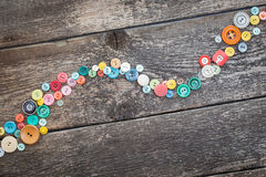 Buttons on wooden boards Stock Photo