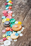 Buttons on wooden boards Stock Photography