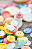 Buttons on wooden boards Stock Photos