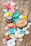 Buttons on wooden boards Royalty Free Stock Image
