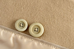 Buttons on wool fabric Stock Images