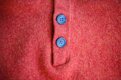 Buttons on woolen sweater. Royalty Free Stock Images