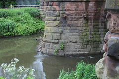 Buttresses in the River Rother. Buttresses to the railway bridge over head.  they are in the River Rother Royalty Free Stock Image