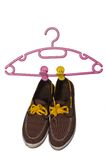 Buty i wieszak odizolowywający na białym tle Zdjęcie Stock
